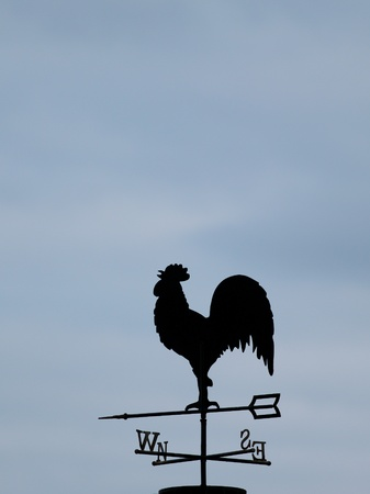 Silhouette of a weathercock against sky with cloudscape Stock Photo - 13956330