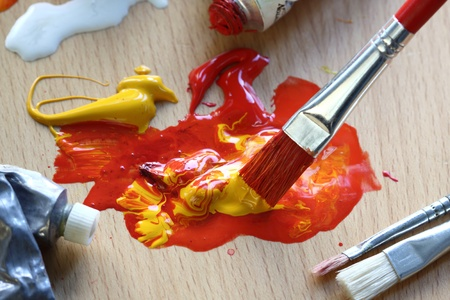 Close up of colorful paint and brush. Focus in the brush  photo
