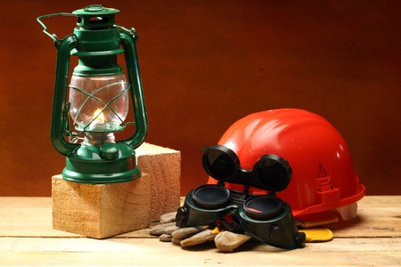Safety gear kit and oil lamp close up photo