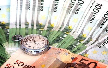 Chronometer and euro bills close up  photo