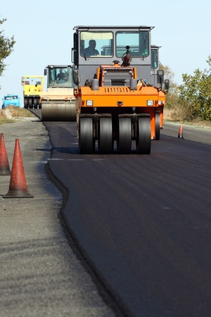 roller compactor: Road roller in work on the road