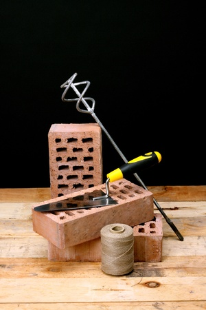 Bricks, trowel and stirrer on  work place  Stock Photo - 16250940