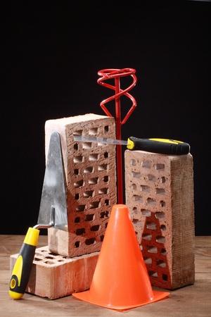Bricks, trowel and stirrer on work place Stock Photo - 16554357