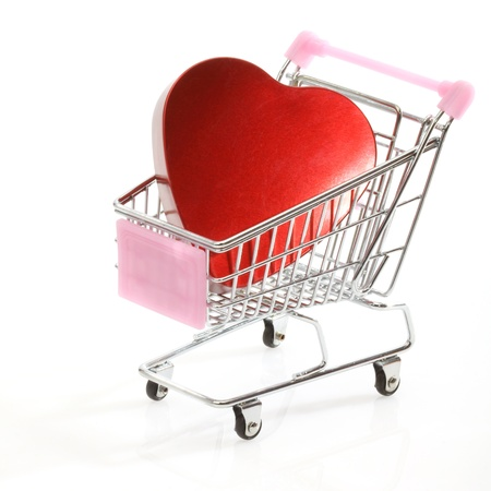 Red heart in shopping cart over white Stock Photo - 16554327