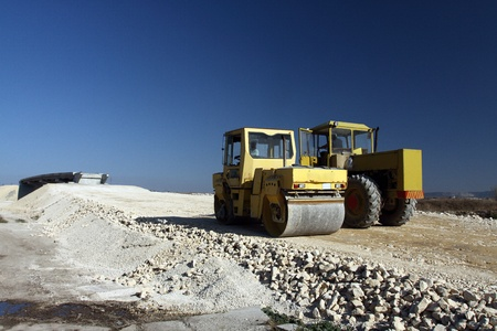 Road rollers working at road construction site