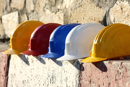 accident at work: helmets close up on work place  Stock Photo