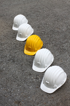 row of white and yellow helmets photo