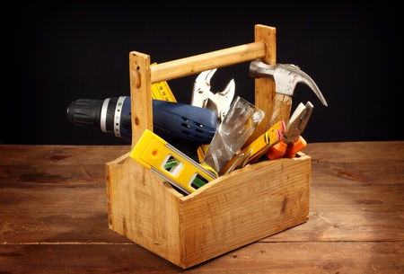 wooden tool box at work on a black background