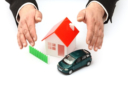 Hands, car and house model  Real property or insurance concept  Imagens