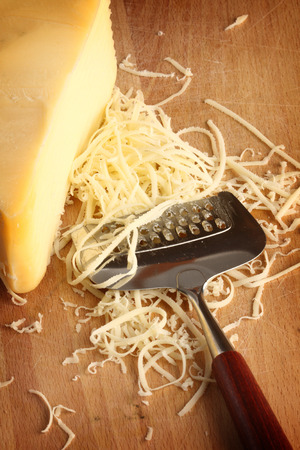 Grated cheese with grater, close up  photo