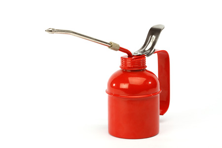 oilcan: Red oiler close up over white background