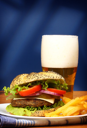 Close up of big tasty burger, french fries and beer photo