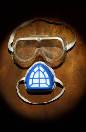goggles and a mask as a human face. safety concept photo