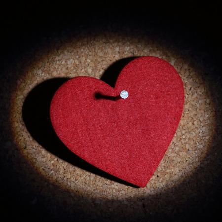 heart pinned with a nail photo