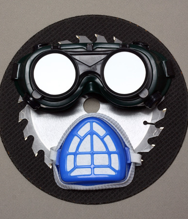 goggles and a mask as a human face  safety concept photo