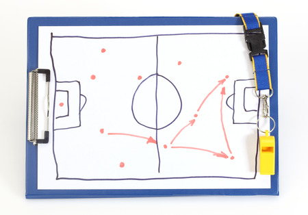 Clipboard with soccer tactical plan on white photo