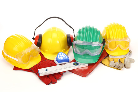 dangerous construction: Safety gear kit - color helmets on white