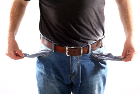 Man with empty pockets on white background photo