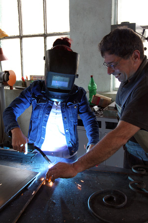 Two workers welding metal construction  photo
