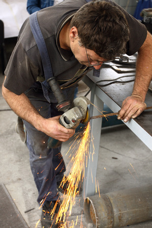 a worker working with Angle Grinder photo