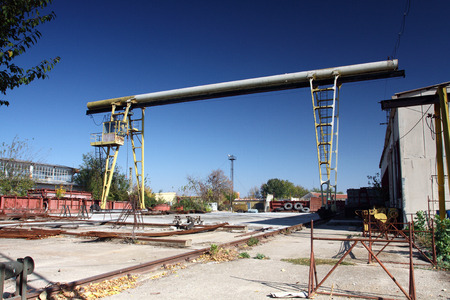 old yellow gantry crane, view from industrial yard photo