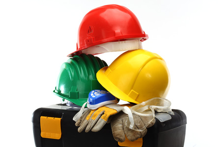 protective helmets: Some color protective helmets and toolbox on white
