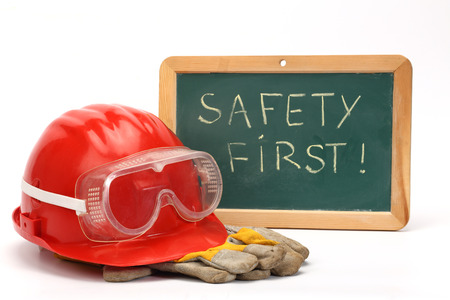 safety first: helmet, goggles, gloves and greenboard. safety first concept