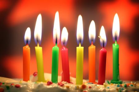 eight lit birthday candles close up, shallow dof Banco de Imagens