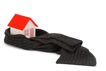 insulate: Model of house wrapped in dark scarf over white