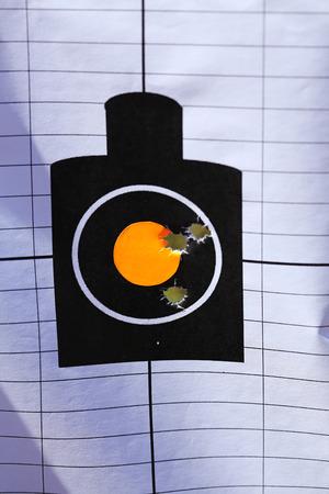 marksman: shooting range target with bullet holes