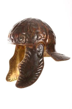 ancient bronze roman helmet over white