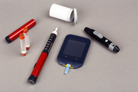 hyperglycemia: Diabetes equipment, Insulin pen and glucose level blood test Stock Photo