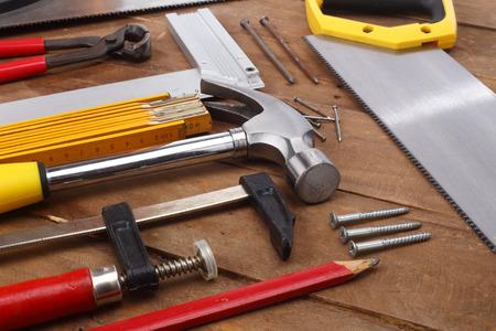 yardstick: carpenters tools close up on work bench