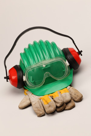 earmuff: Safety gear kit close up over grey Stock Photo
