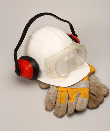 safety gear: Safety gear kit close up over grey Stock Photo