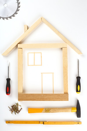 yardstick: shape of house made out of tools over white