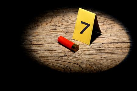 coroner: shotgun shell marked as evidence in a spot light
