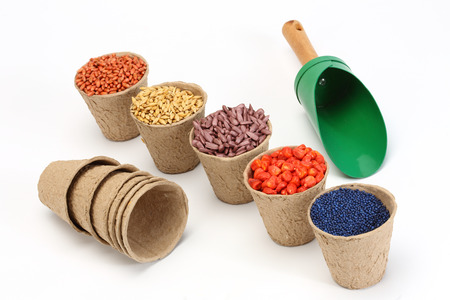 dibble: colored various sowing seed in paper pot Stock Photo