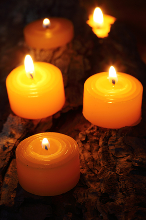 in loving memory: Burning tea candles close up, with selective focus