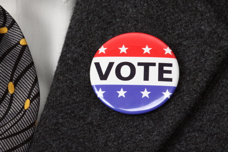 vote button: man with Vote button  pinned on his  suit Stock Photo