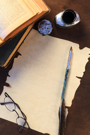 glases: A blank sheet of paper and quill