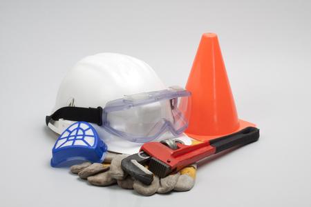 safety gear: Safety gear kit close up on grey background