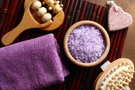 bath salts: purple towel, lavender bath salts and relaxing bath accessories Stock Photo