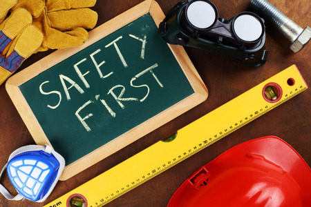 safety first: tools and board with the inscription SAFETY FIRST Stock Photo