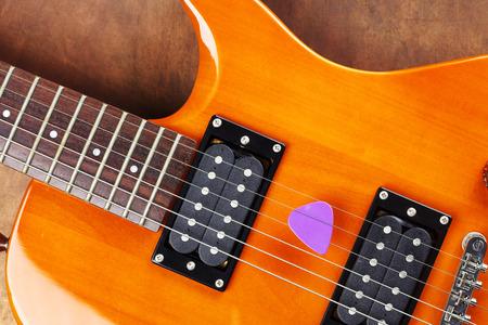 guitar pick: a violet guitar pick and electric guitar