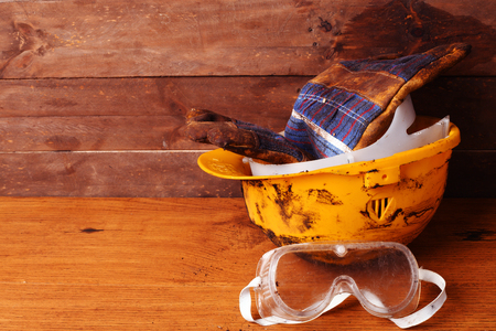 yellow helmet: Dirty yellow helmet and tools on work place
