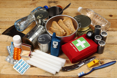 Items of emergency on wooden table