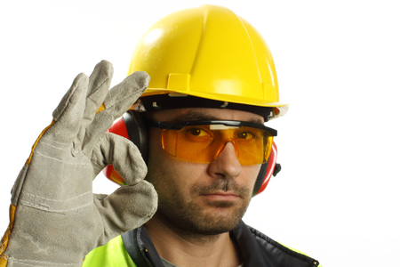 Worker with protective gear with OK sign photo