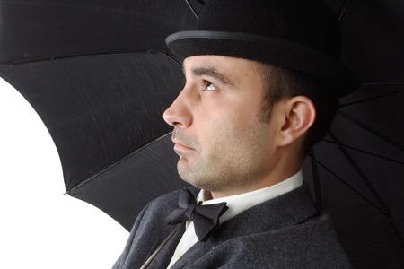 portrait of dandy man with umbrella photo