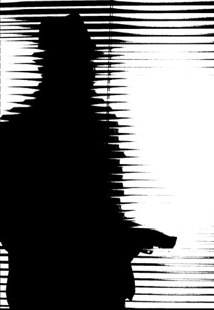 peep: silhouette of an armed man behind blinds Stock Photo